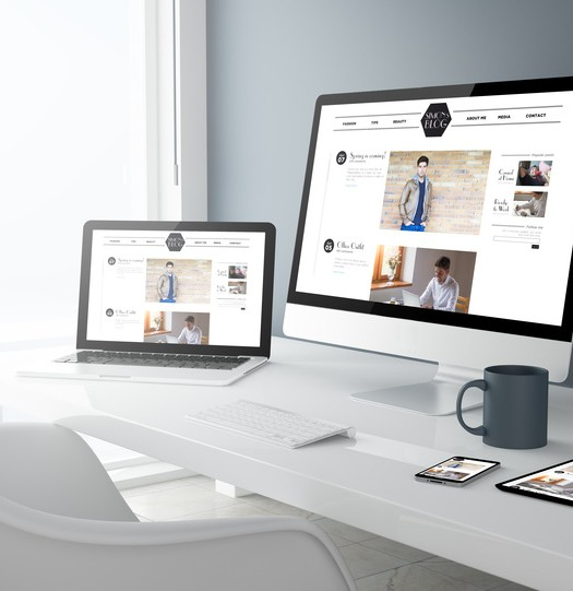 3d rendering of desktop with all devices showing modern design blog. All screen graphics are made up.