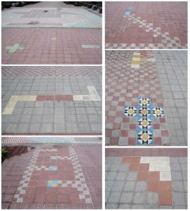 """""""Ta_patio"""", dibujos y símbolos alrededor del signo en tramo de alrededor de 150 metros, Paseo Chapultepec, Alejandro Fournier, 2009-2011"""